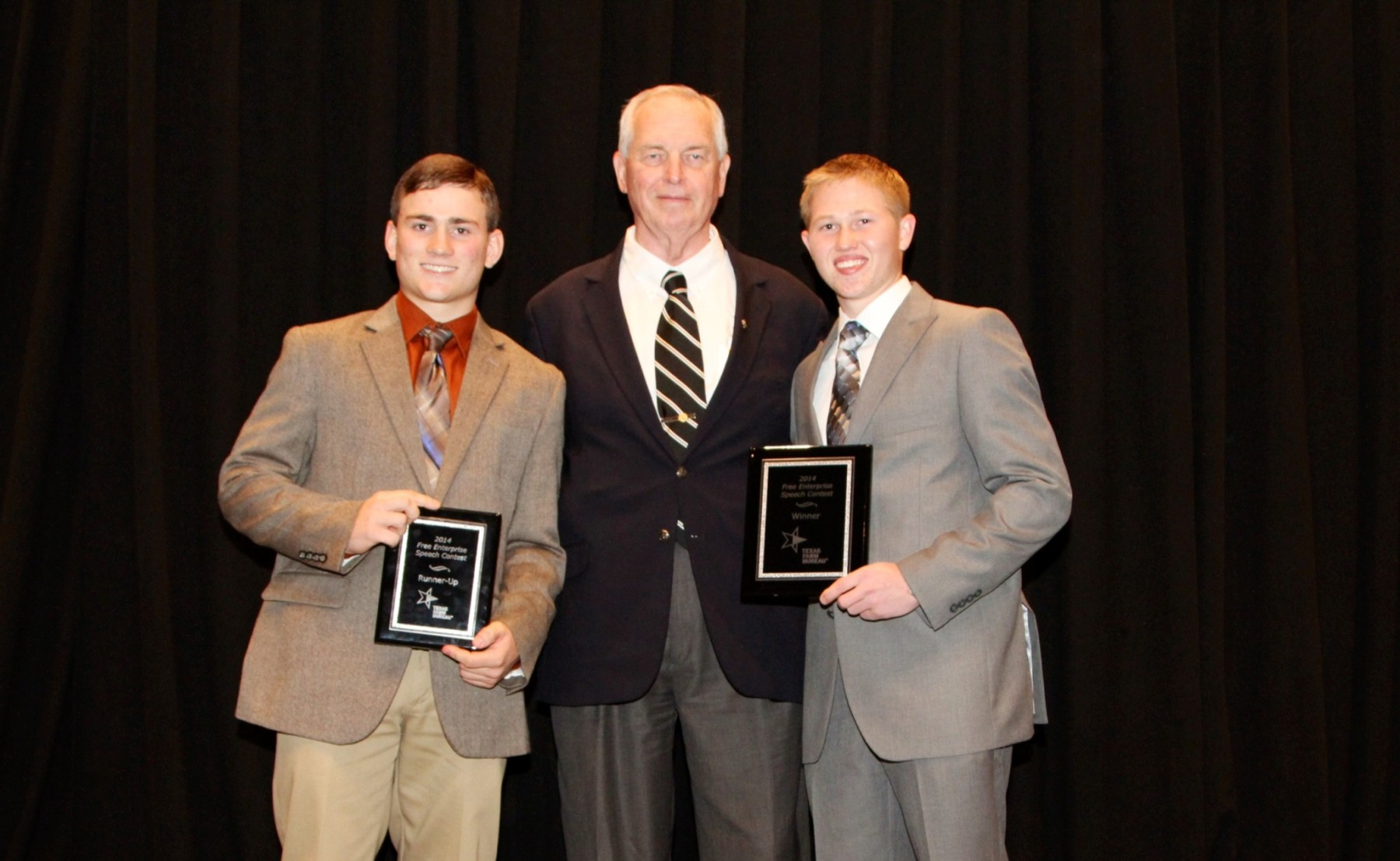 Conner McKinzie of Erath County (right) and Dylan Davidson of Childress County (left) have been named winner and runner-up, respectively, of Texas Farm Bureau's 2014 Free Enterprise Speech Contest at the 81st Annual Meeting in Corpus Christi. || Photo by Texas Farm Bureau