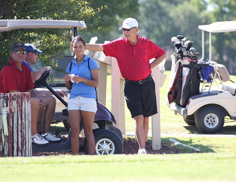 Golfers wait their turn on the front nine at Legends Country Club last summer.    Photo by BRAD KEITH