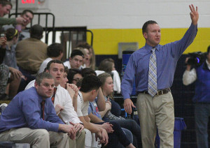Outgoing Stephenville boys basketball coach Jonathan Normand, standing, hopes to hand over the reigns of the program to assistant Bill Brooks, seated second from left. || BRAD KEITH/TheFlashToday.com