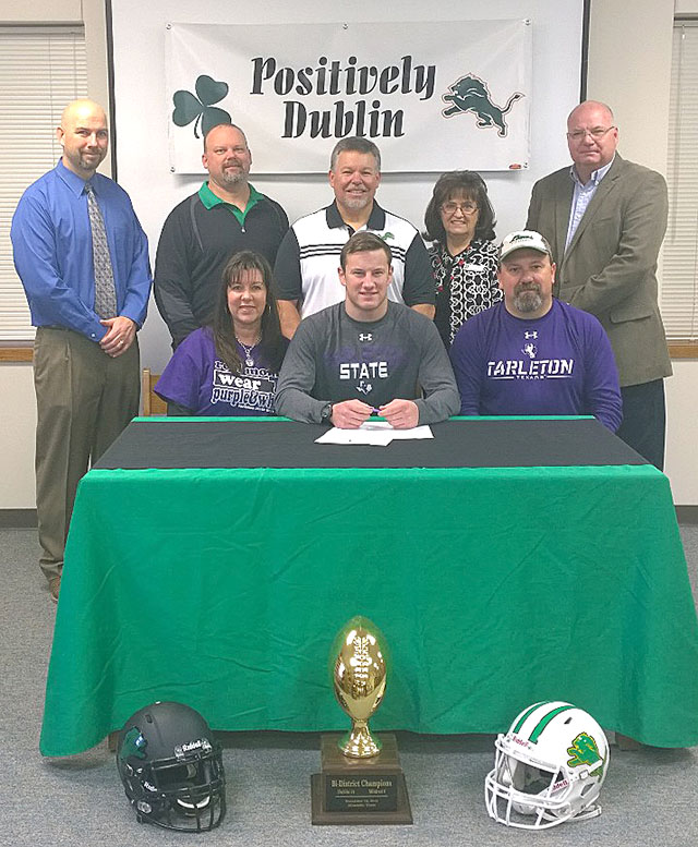 Dublin quarterback Brady Holleman was surronded by his parents, coaches and school administrators when he signed with the Texans Wednesday morning. || Photo by BRAD KEITH