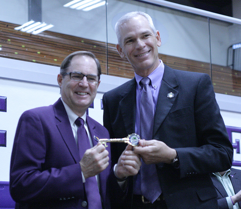 Mayor Kenny Weldon presents Tarleton head coach Lonn Reisman with a Key to the City of Stephenville Monday at Wisdom Gym. || Photo by BRAD KEITH/TheFlashToday.com