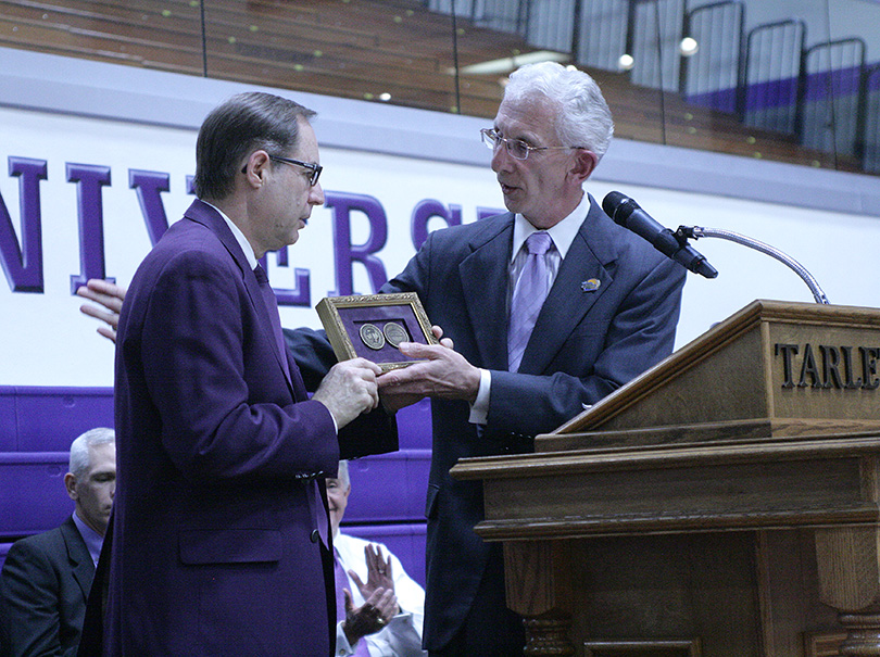 President F. Dominic Dottavio presents Tarleton men's head coach and director of athletics Lonn Reisman with a seal representing the core values of the university. || Photo by BRAD KEITH/TheFlashToday.com