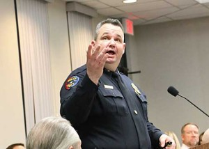 Stephenville Police Chief Jason King points to a chart during his report to the council.