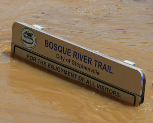Bosque River Trail sign during Friday's flooding.
